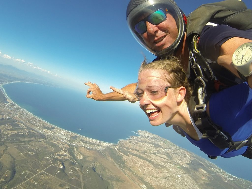 Female tandem student wearing blue smiling in free at Garden Route, South Africa near Cape Town