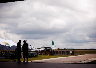 Two males standing outside near Skydive Mossel Bay's skydiving planes