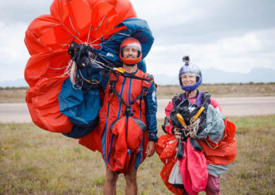 Male and female smiling post skydive in Mossel Bay, South Africa