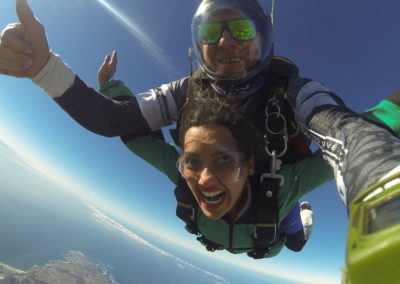 Tandem skydiving with arms stretched out while in free fall in Mossel Bay, South Africa near Cape Town