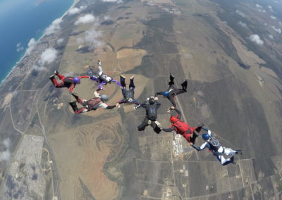 8 experienced skydivers in formation in Garden Route, South Africa