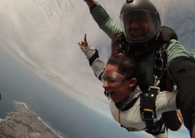Student and Tandem instructor wearing green shirt skydiving on Garden Route, South Africa