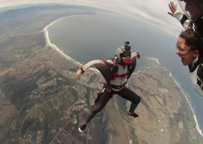 Skydiving videographer in free fall with arms stretched out in Mossel Bay, South Africa