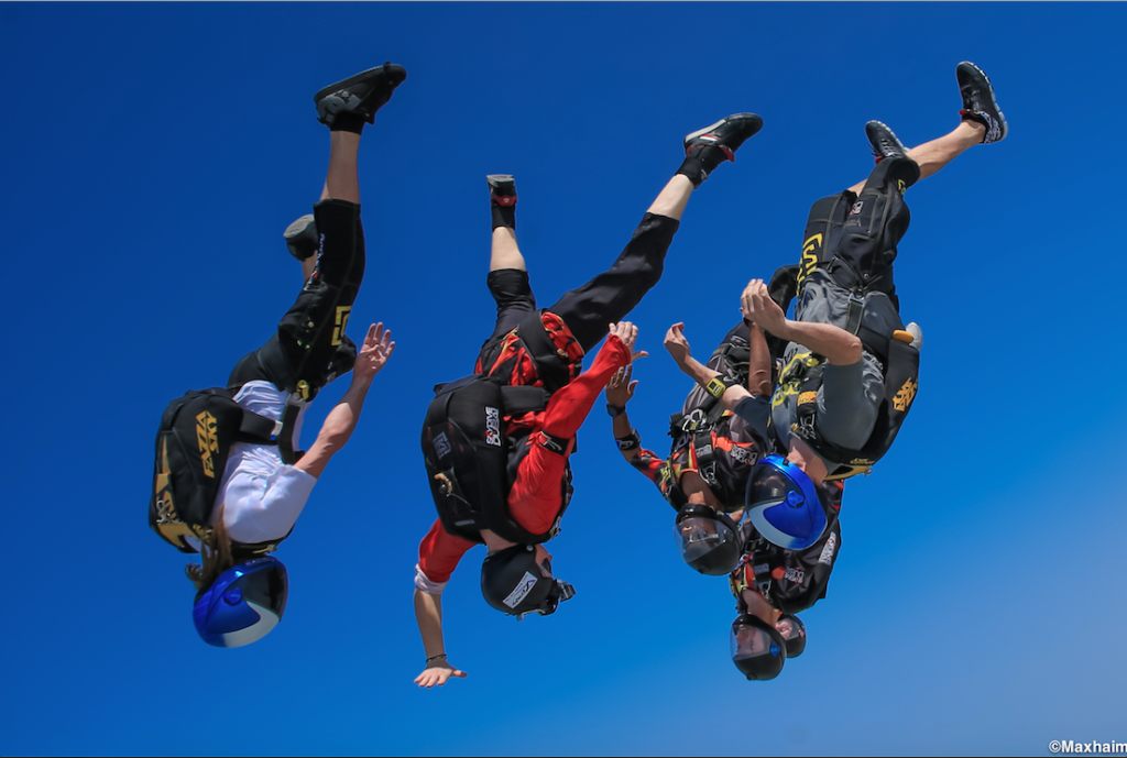 Licensed Skydivers in freefall for sport and having a blast in Mossel Bay near Cape Town
