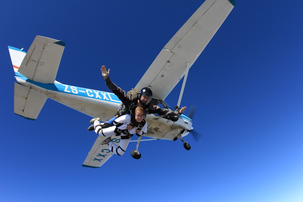 A girl tandem skydiving for the first time