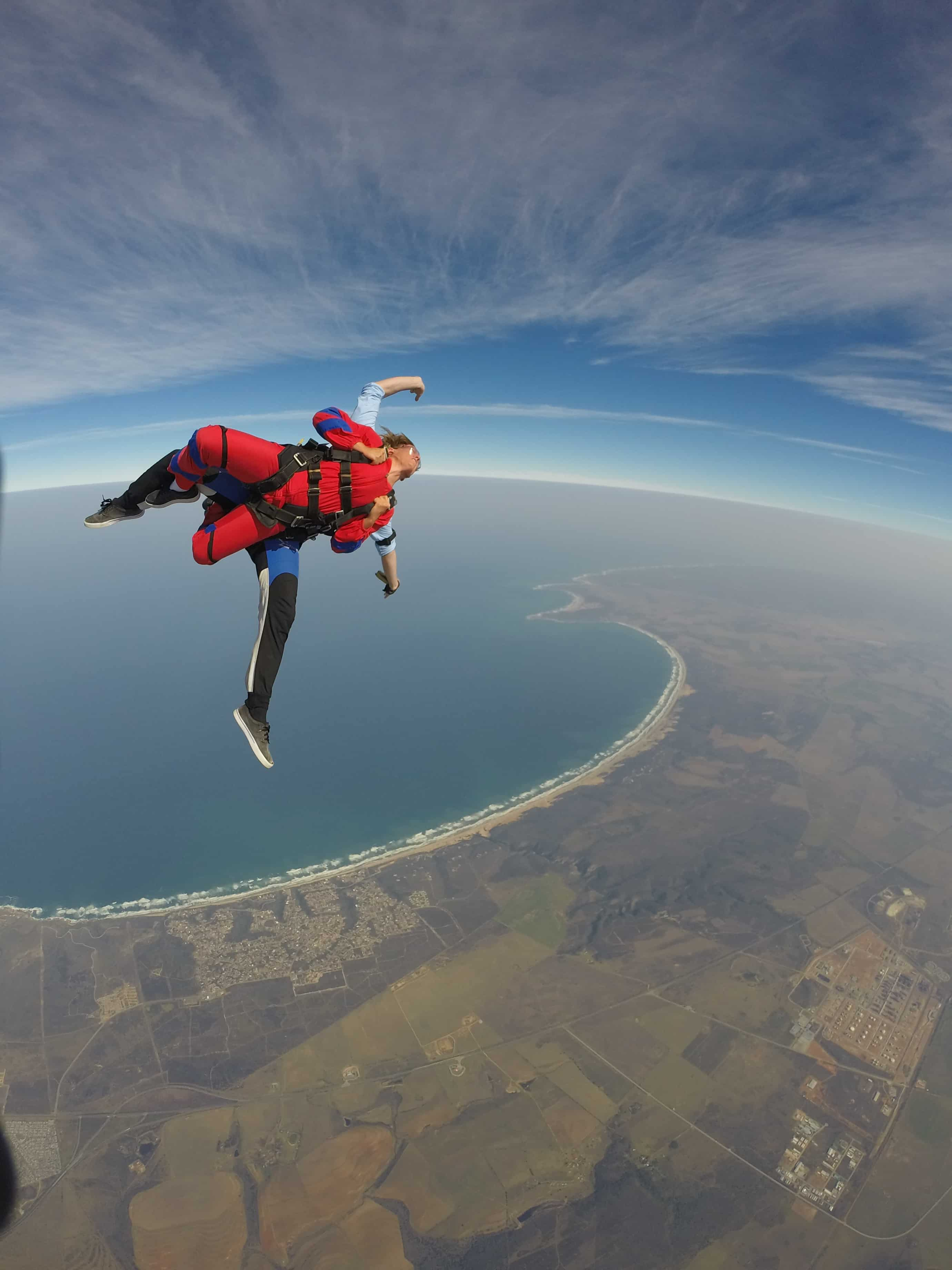 First-time skydivers are tandem jumping over the coast at Mossel Bay