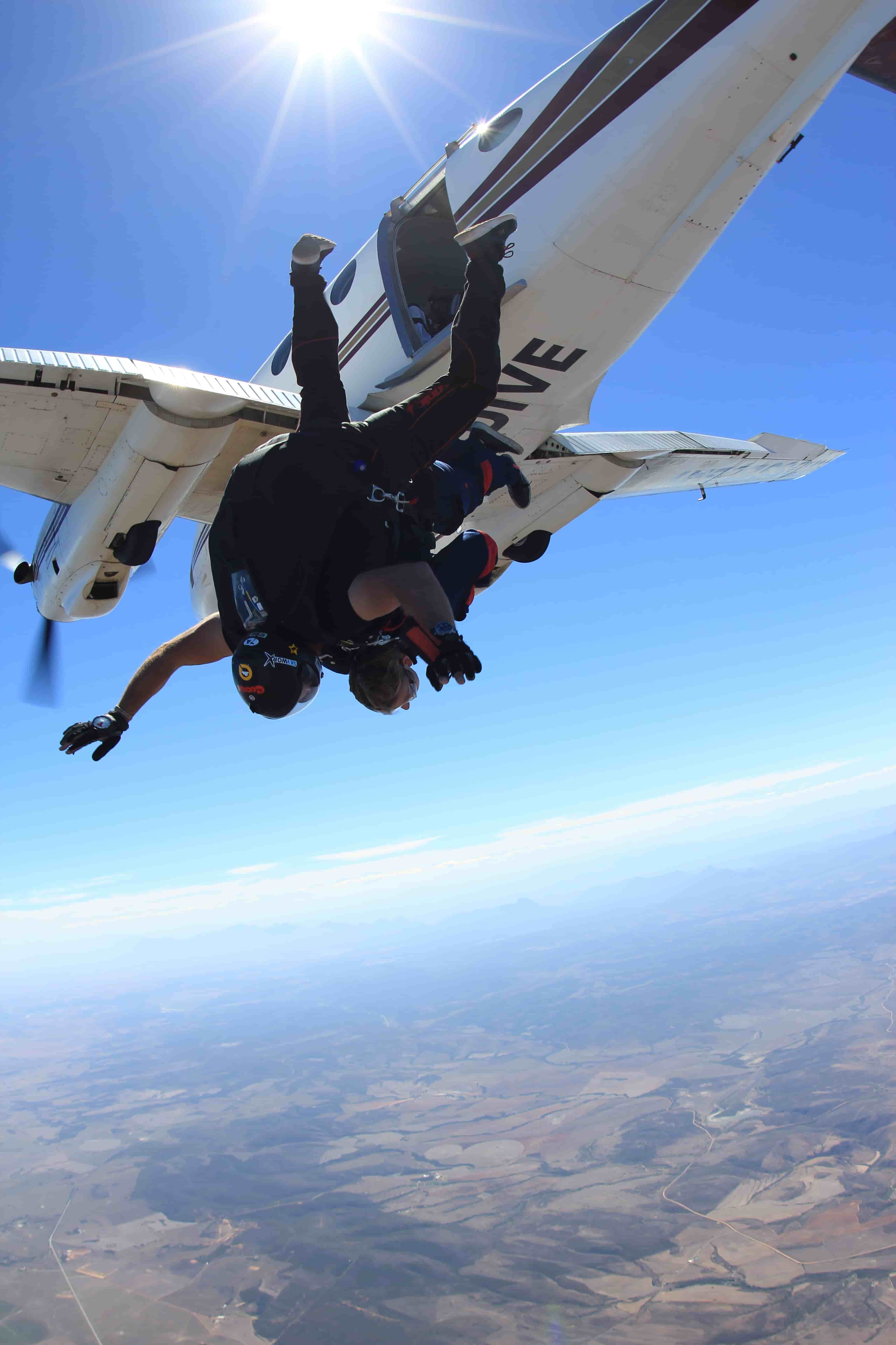 Tandem skydivers jumping from a plane over Mossel Bay South Africa