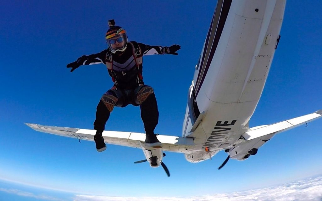 Experienced skydiver jumping from high altitude over Mossel Bay South Africa outside of Cape Town