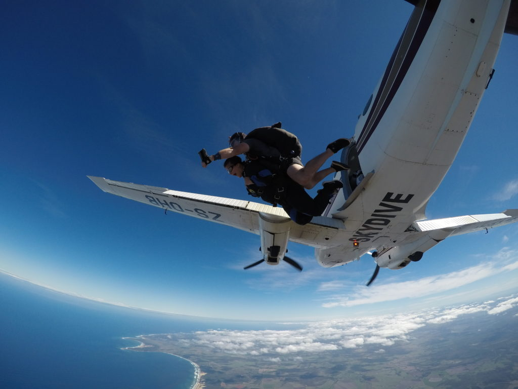 Tandem skydivers jumping from high altitude over Mossel Bay South Africa