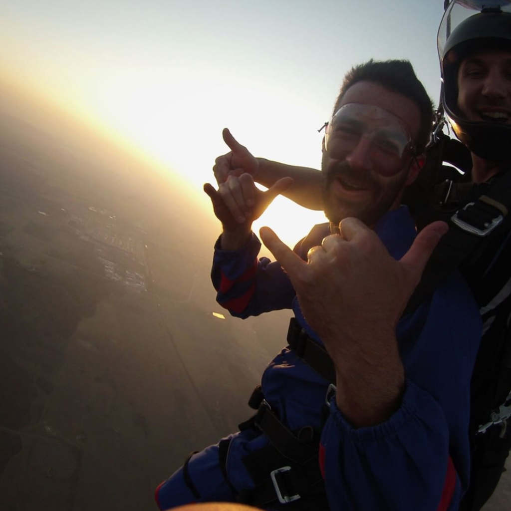 Man parachuting over South Africa during a tandem skydive with Skydive Mossel Bay outside of Cape Town