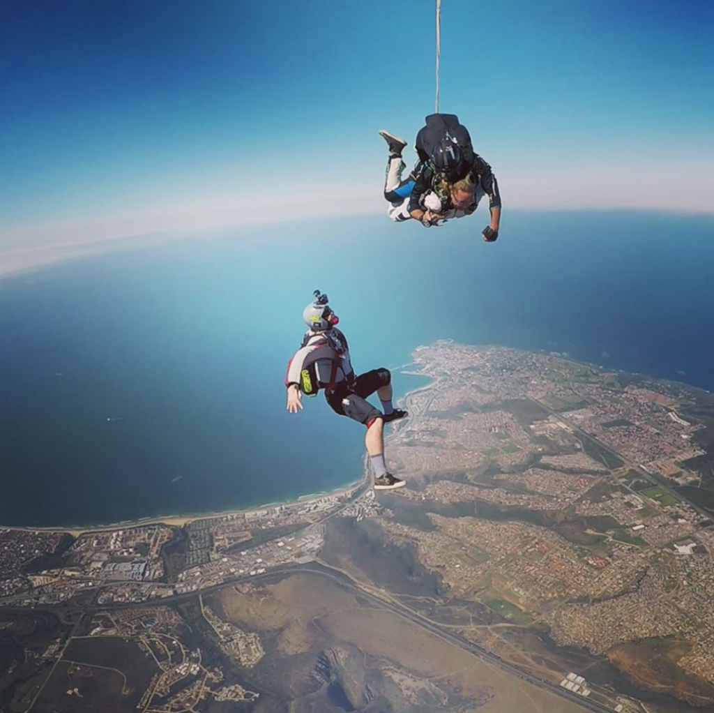 Outside camera man taking video for a tandem skydive over Mossel Bay near Cape Town