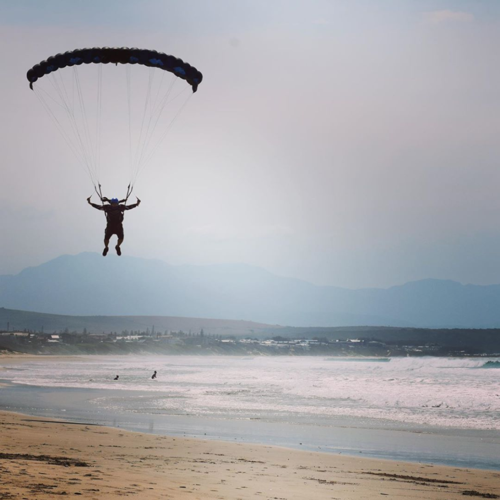 Skydiver from Skydive Mossel Bay landing on a beach near Cape Town