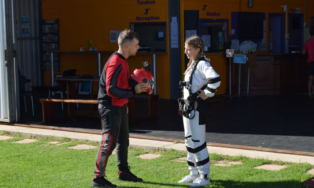 Henk interviews a tandem student before her skydive at Skydive Mossel Bay
