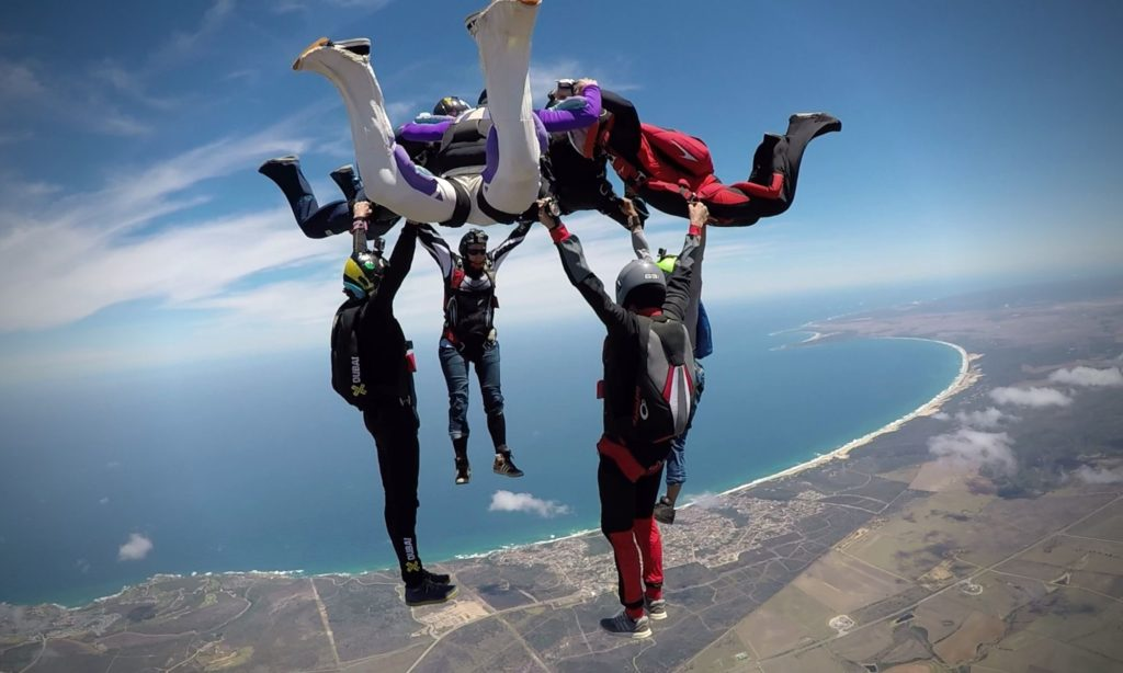 Henco and friends and jumping a hybrid over Diaz Beach at Skydive Mossel Bay