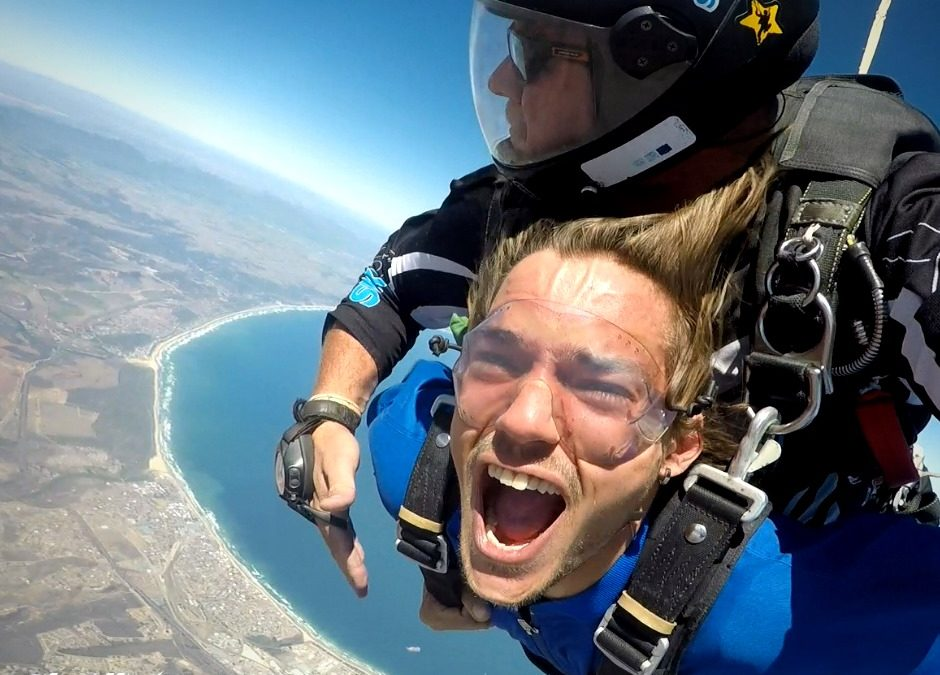 Pure adrenaline and joy during a tandem skydive over Mossel Bay on the Garden Route near Cape Town