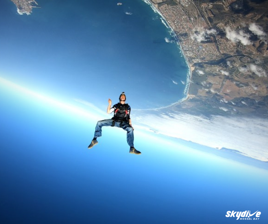 Solo Skydiver in freefall over the beaches of Mossel Bay near Cape Town